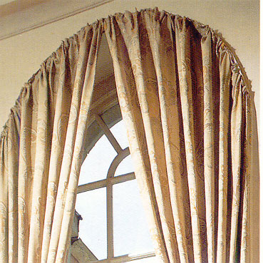 Hang tab top curtain panels from antique hooks installed around the